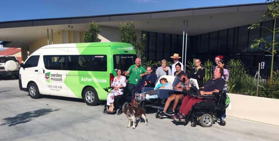 Asher House residents with community bus