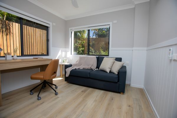 Desk with stylish chair and couch