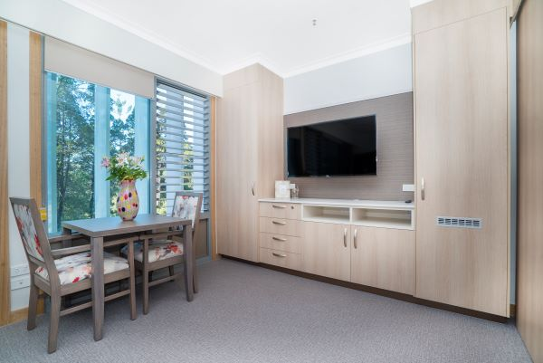 WesleyCare Jindalee room with table and TV