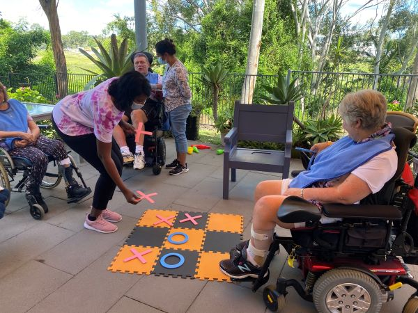 WesleyCare Sinnamon residents playing games outdoors