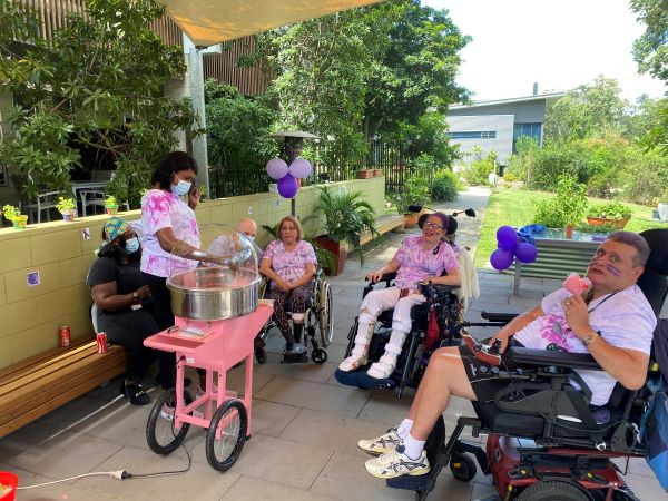 WesleyCare Sinnamon residents having outdoor celebration with fairy floss