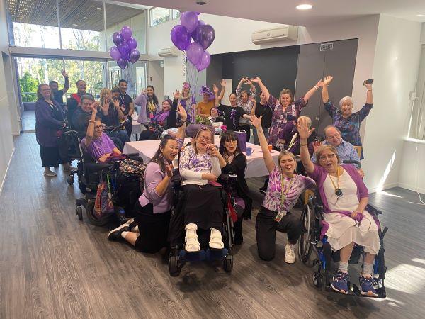 WesleyCare Sinnamon residents celebrating in purple