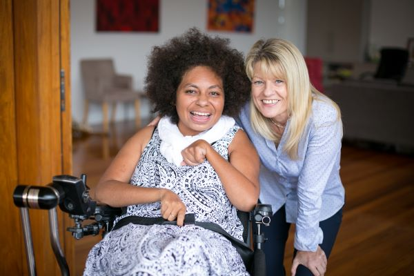 Youngcare Sharehouse Wooloowin resident and staff member smiling