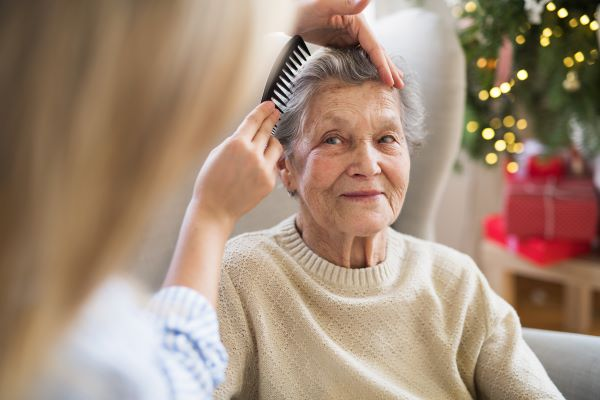 Older lady having hair combed