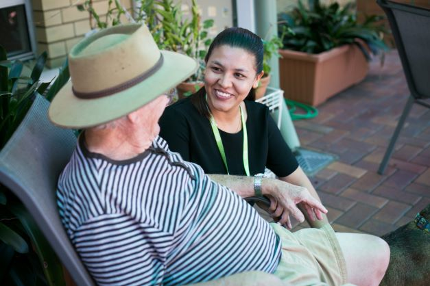 Residential aged care resident with staff member