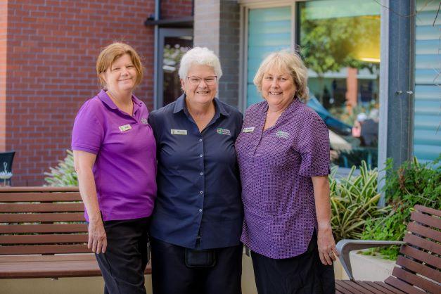 Three team members at John Wesley Gardens