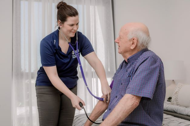 Nursing staff with aged care resident