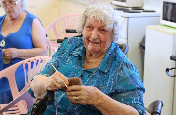 Lady smiling holding handicrafts