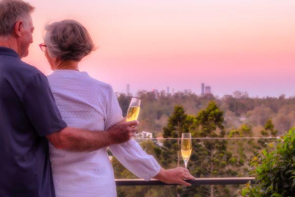 Couple enjoy champagne on balcony