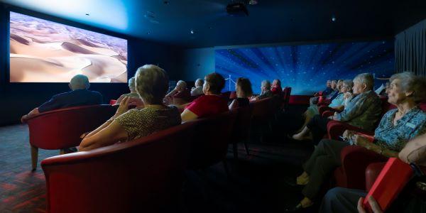 Retirees watching movie in cinema