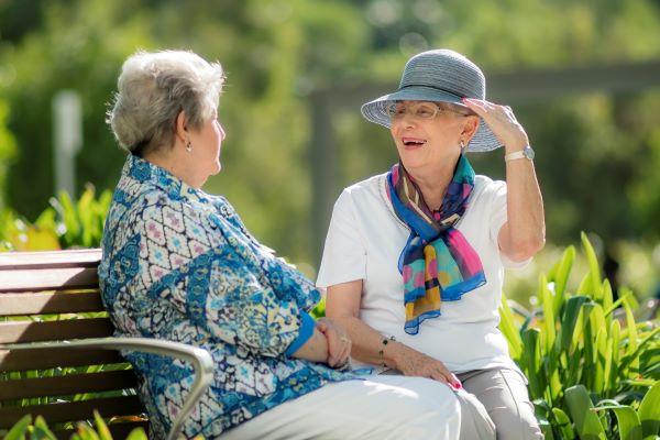 Two ladies talking in gardens