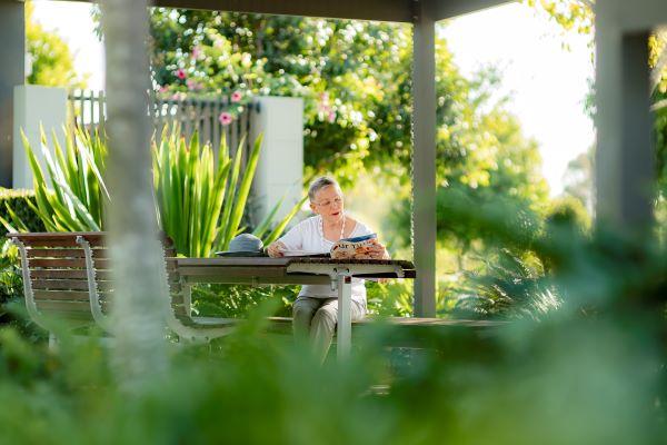 Lady reading in garden