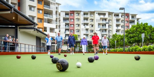Retirees playing lawn bowls