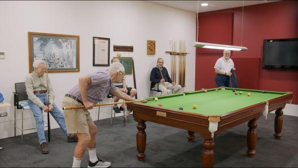 Retirees playing pool