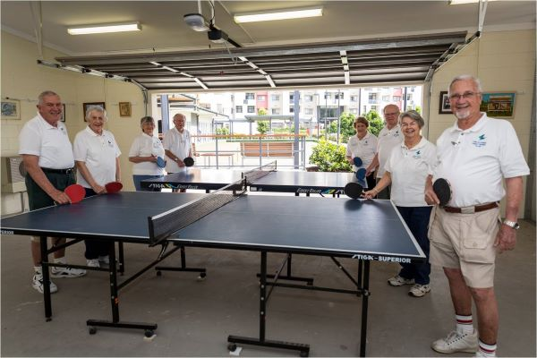 Retirees playing table tennis